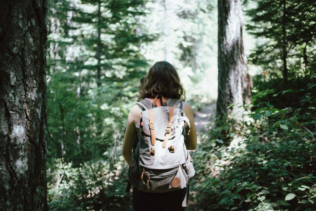Girl hiking in forest